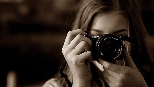 female holding camera