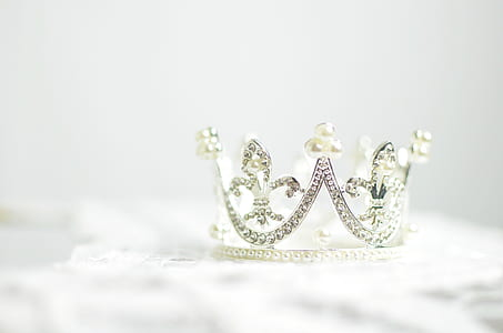 close-up photo of silver-colored crown