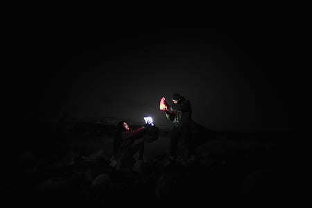 man holding shoe and light