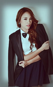 woman wearing white and black dress with bowtie