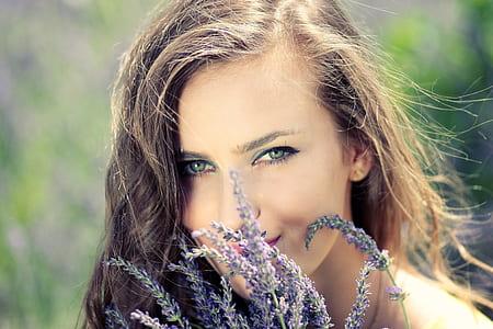 purple lavender infront of woman face