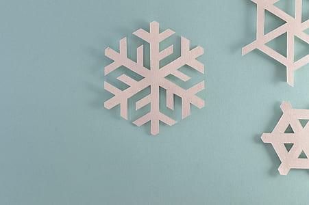 white wooden snowflake wall decor