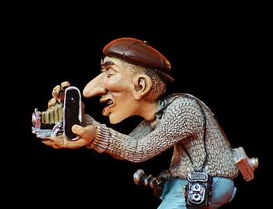 gray dressed man holding a camera illustration
