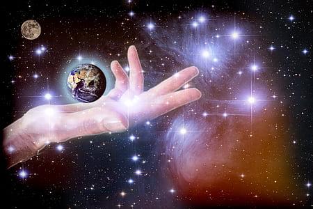 human arm holding planet illustration
