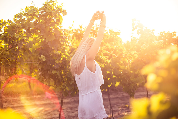 Young Girl Enjoying Happy Moments and Dancing in Vineyard
