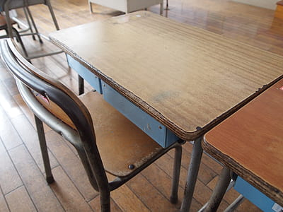 rectangular brown wooden table beside armless chair