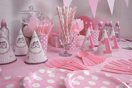 white and pink party hat set