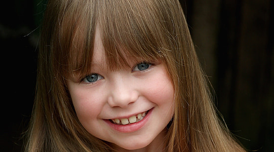 selective focus photography of smiling girl face