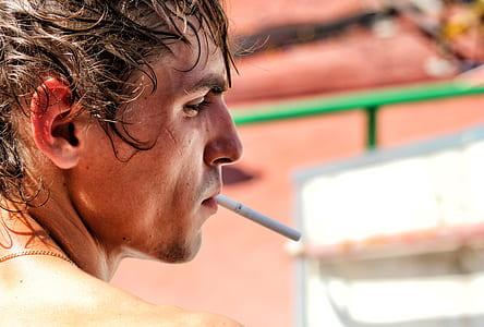 man with white cigarette stick