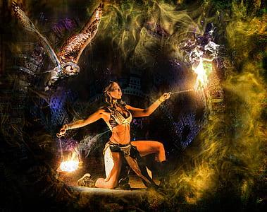 woman doing fire dance during nighttime