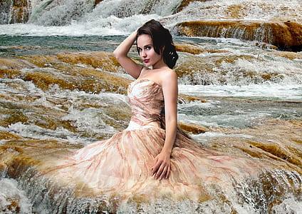 woman in brown dress on waterfalls