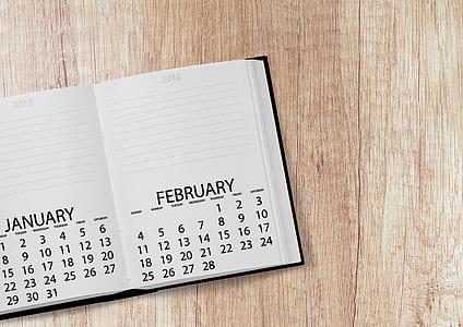 closeup photo of white and black calendar book
