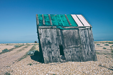 Shot of an old abandoned shack that has started to subside. Image captured in Dungeness, Kent, England