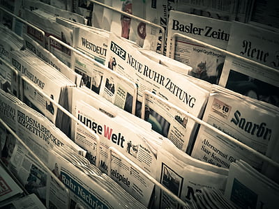 pile of newspapers on rack