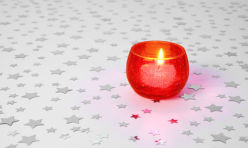white candle with red candle holder