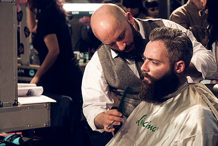 photo of man getting hair cut