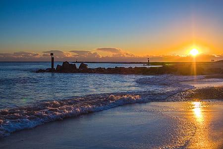 photo of a sunrise on seashore