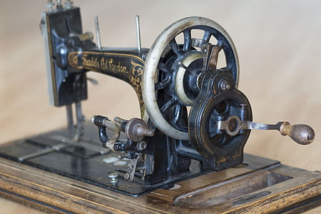 black sewing machine on table