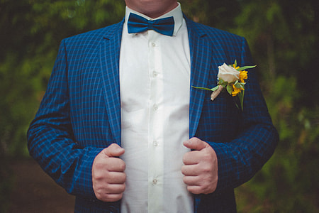 Wedding groom in suit and bow tie