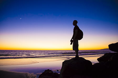 man standing on stone silhouette