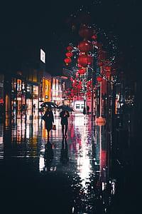 two people walking white holding umbrellas