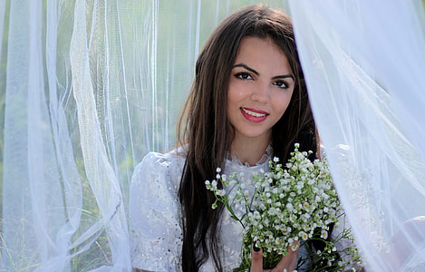 woman wearing white bridal gown smiling