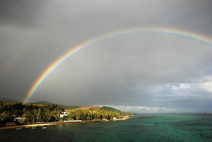 rainbow on shore and sea