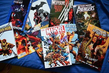 assorted comic book lot on blue textile