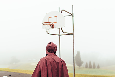 man standing in front of basketball hoop
