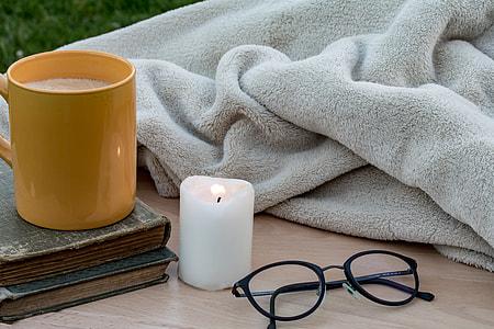 black plastic framed eyeglasses near white pillar candle