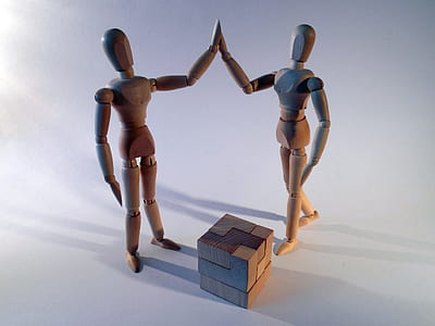 two brown wooden figure