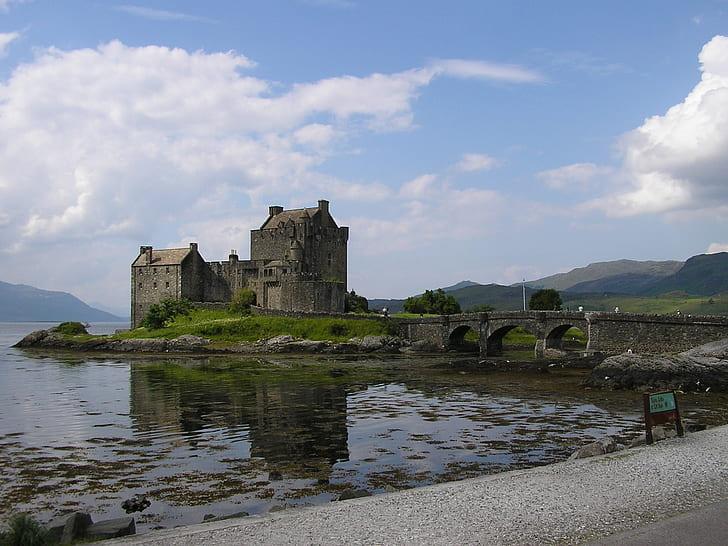 gray concrete castle near body of water