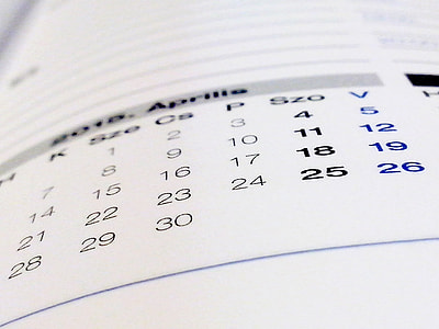 selective focus photography of white and black April calendar