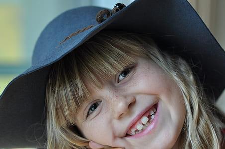 girl wearing black sun hat