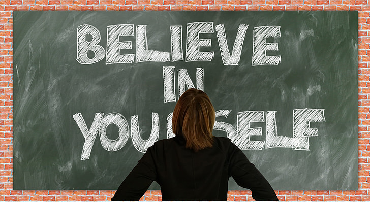 Royalty-Free photo: Person in black long-sleeved top facing blackboard with  believe in yourself text | PickPik