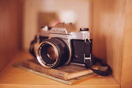 shallow focus photography of Pentax SLR camera