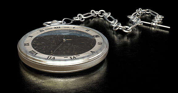 black and silver pocket watch