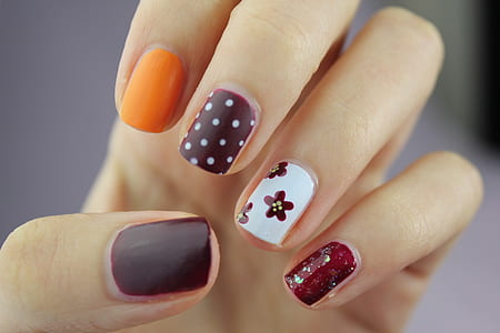 selective focus photography of assorted colored nail art