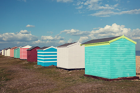 Coloured beach huts sit on the coast of Greatstone in Kent, Southern England. Image captured with a Canon DSLR