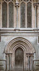 brown concrete arch door