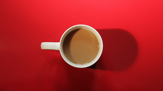 above angle photo of white ceramic mug with brown coffee in it