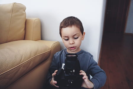 Boy Holding Black Dslr Camera