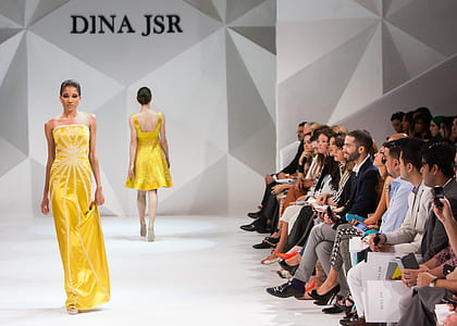 woman wearing yellow tube dress on model runway