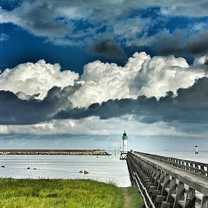 white lighthouse under white cloudy sky