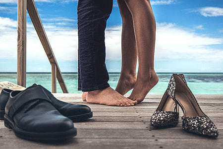 Couple in love kissing with shoes taken off