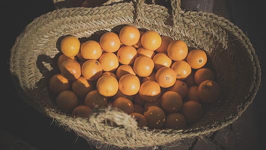 orange fruits in brown basket at daytime