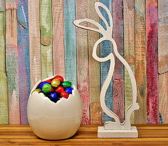 white wooden rabbit and assorted-color eggs