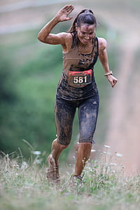 shallow focus photography of woman covered by mud