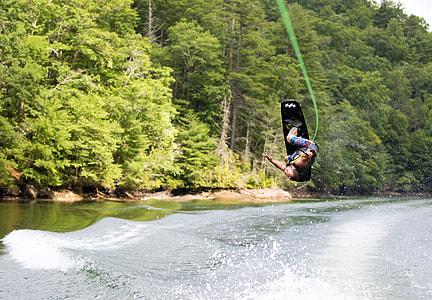 man wakeboarding during daytime
