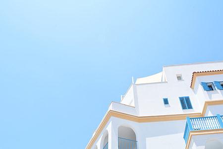 white and blue concrete building under calm sky